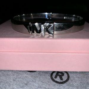 Michael Kors Jewelry - MICHAEL KORS LOGO CRYSTAL HINGE LOCK BRACELET.